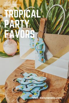 Tropical theme party favors are fun for adults and kids. From a pool party, luau or beach bachelorette party, these pineapple keychains are sure to please. The cute pattern features palm trees and pineapples. Add the keychains to tropical theme goodie bags or display them on a table to add to your beach party decor. Gift them to your friends for a girls beach getaway. Take the guess work out of beach party planning with an easy party favor idea that is unique and fun! Visit daisylaneco.com
