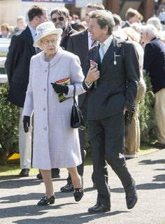 Queen Elizabeth II with her racing manager John Warren at Newbury Racecourse on 20 April 2013 where she watched her horse 'Border Legend' in Race 3 '.