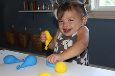 Sensory Balloons - fill them with flour, water beads, hair gel, etc.  Also a good sorting activity for the little ones.