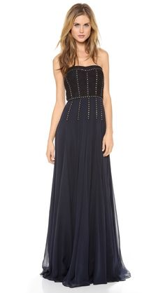 Bands of iridescent rhinestones add sparkle and visual structure to a lace and chiffon Rebecca Taylor dress. Flexible boning supports the strapless bodice, and an exposed zip closes the back. Lined.