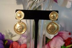 """Use Coupon Code for 10% off Vintage Givenchy Goldtone Drop Dangle Earrings Pierced with Givenchy Logo. 1.5"""" L. These Earrings feature the Givenchy Logo. The Earrings are Pierced and feature the gold Givenchy Logo. The Earrings are in excellent condition. Free Shipping to the United States.  www.CCCsVintageJewelry.com"""