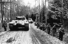 Several Panther Ausf G tanks moving forward during the Ardennes Offensive of 1944
