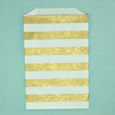 This listing is for a set of 20 high quality paper bags in metallic gold stripe pattern. Perfect for favors, treats, packaging and wrapping.