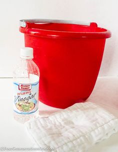 Best way to clean windows {spring cleaning} - hot water in bucket, 2 cups white vinegar, 2 cloth diapers.