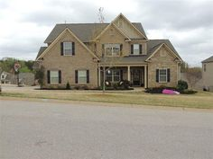 Exceptional schoolsconvenient to GSP. Greenville Greer and Spartanburg COMMUNITY POOL Impressive design featuring 5 bedrooms and a spacious Loft Den this LIKE NEW HOME has it Spacious kitchen with granite stainless appliances 2 pantries and great counter top space. Island breakfast bar and breakfast area Area SHOWCASE STAINED CABINETSample storage AND MUCH OF THE DOWNSTAIRS HAS NEWLY INSTALLED HAND SCRAPED WOOD FLOORING. Master bdrm wsitting rm and 2 walk-in closets plus a guest room wfull…