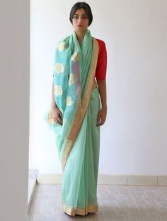 A sweet mint sari by Raw Mango for a day wedding. Shop for your family wedding wardrobe with a personal shopper & stylist in India - Bridelan, visit our website www.bridelan.com #Bridelan