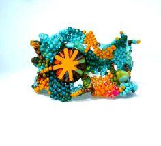 He encontrado este interesante anuncio de Etsy en https://www.etsy.com/es/listing/157063556/beaded-jewelry-bracelet-seed-bead