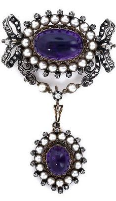 Large Victorian Amethyst Pearl and Diamond Brooch/Pendant. This large, impressive and versatile pin and pendant combo features two deep purple amethyst cabochons, each circumscribed by a halo of pearls and tiny rose-cut diamonds. The top section is enveloped by a classic bow motif of rose-cut diamonds and the bottom section is removable and may be worn on its own. Two brooches and two pendants in-one! Silver over gold, hallmark on pin.