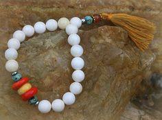 Shell Wrist Mala Bracelet by look4treasures on Etsy, $24.95