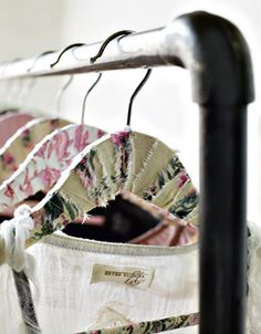 Recycling old clothing with cute patterns u can't bare to throw out- way to keep it in the closet still but with a cute use ( turning old boring hangers into pretty ones!!