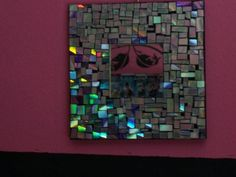 Mosaic mirror from old cd's.... I have TONS of old, scratched up cd's.  I will most definately have to try this!