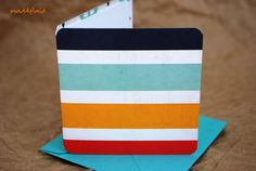 This listing is for a set of ten mini cards done in a bright tropical cabana stripe with a contrasting anchor pattern on the inside. They are square