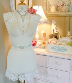 The ultimate in combining jewelry storage and decor using a dress form with lace and ribbon touches.