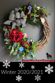 Holiday/Winter Wreath by DeanMichaelDesigns. This wreath features a deep red peony on a bed of ficus and frosted eucalyptus. The bow is black and white strips that accent any décor. Interior design. Exterior design. Curb appeal. Holiday decorating.