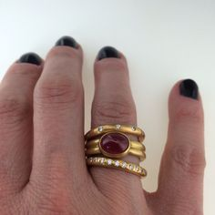 22k gold stack with cabochon ruby ring by Reinstein/Ross available @quadrum