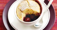 Indulge in these beautiful sponge puddings with a hidden layer of berries underneath.