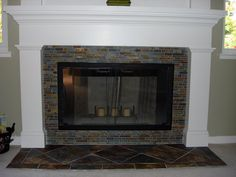 Black subway tile fireplace with white mantel and trim - Really Clean look  I think we can also do