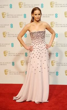 Who made Jennifer Lawrence's strapless gown, jewelry, clutch handbag, and shoes that she wore in London on February 10, 2013? Dress – Dior Haute Couture Shoes – Jimmy Choo Jewelry – Chopard Purse – Judith Leiber