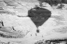 Sailing over a  brick factory, village kids chasing the balloon. Jaipur, India