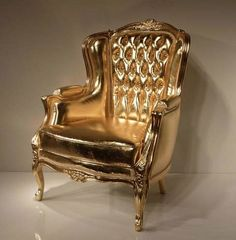This gold chair is sinfully glamorous. The frame is hand-carved and finished in a gorgeous gold leaf that brightens up any room The combination of the timeless frame design and the modern, gold leather upholstery makes it an incredibly fun and beautiful c Tufted Chair, Armchair, Wing Chair, Chesterfield Chair, Gold Furniture, Furniture Design, Gold Everything, Or Noir, Shades Of Gold