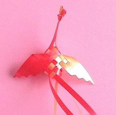 """Ribbon Bird from two colors of 3/4"""" gift wrap ribbon. What a great idea for on top of the package or for party decor    icandream.com"""