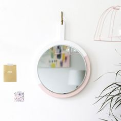 Transform a simple kitchen tool with this brilliant hanging mirror DIY!