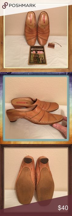 EUC PIKOLINOS Tan Leather Slides SZ 38 w/cards Great pair of PIKOLINOS Tan Leather slides with Green, Tan & Burgundy Leather lines across the tops. They look awesome with blue jean shorts. My Daughter wore them for awhile & we can't figure out how it got a small wrinkle at the bottom of 1 heel unless it was there when I bought them & didn't catch it because there is no damage to the bottoms at all. It's not noticeable at all while on your feet, they are so comfy but too big for me ☹️ SZ 38…