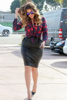 Khloe Kardashian showed off her killer curves as she ran errands in Los Angeles on Monday, sporting a Rails plaid button down with a booty-hugging black leather skirt. She completed her look with black Christian Louboutin pumps, Victoria Beckham aviators and perfectly tousled curls. | toofab.com