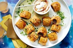 Make ahead and freeze before you bake for the ultimate easy weekend saver. Lamb Sausage Rolls with Harissa Sauce Canapes Faciles, Christmas Party Snacks, Savory Pastry, Savoury Pies, Custard Cake, National Dish, Lamb Recipes, Sausage Recipes, Sausage Rolls