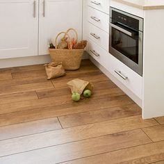 kitchen flooring | for Wooden Kitchen Flooring | lighter wood color with white cabinets