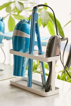 7 Bathroom Storage Ideas For Hair Tools // Organized Right on the Counter --- Using a holder that sits right on the counter ensures that your hair tools are always well within reach but eliminates chaos by giving them their very own designated spot on the counter.