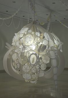 Artist Kirsten Hassenfeld, paper installations, lovely! .........hanging/bundle collage,,,strings!!!!!