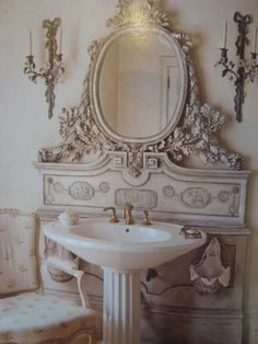 Is it a revamped headboard or a piece of an old vanity? Whatever it is, it's wonderful! For a guest bathroom, maybe?