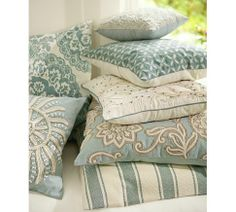Love this color scheme -- Pottery Barn's Coastal collection for summer.  Want the one with the tan/white flower-like appliques (second from bottom) but can't find it on their website