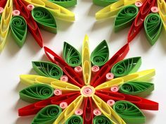 Snowflake Green Yellow Red Pink, Quilled Handmade Art, Paper Quilling, Home Decoration Idea, Christmas Tree Decor, Winter Ornaments, 3 pcs. You can hang it on Christmas tree, use as fridge magnet, decorate Your bookshelf, dinner table or put it in lovely frame. This listing is for 3 snowflakes. Dimensions of one snowflake - 3.5 ″ x 3.5 ″ (8.5 cm x 8.5 cm) - a nickel (5 cent coin) for scale. Made from 1/4 ″ (5 mm) paper strips of 90 g/m2 paper.