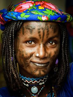 Africa | Mbororo woman photographed in Cameroon. The Mbororo belong to the Fulani/Peul ethnic group. Especially the women, traditionally tattoo their faces.