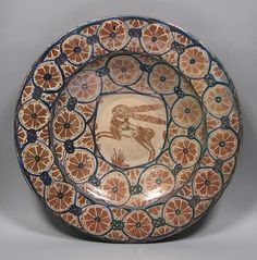 Dish Date: ca. 1450 Geography: Made in probably Manises, Valencia, Spain Culture: Spanish Medium: Tin-glazed earthenware Dimensions: Overall: 14 3/8 in. (36.5 cm)