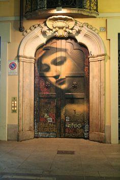 Painted door in Milan, Italy