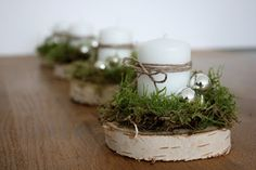 Moss wrapped candles on coasters. 50 Nature Inspired Holiday Decor Ideas - A Little Tipsy