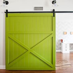 Love this lime green barn door! Bold statement in your home.