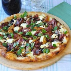 Caramelized Pear Prosciutto Pizza - the combination is sweet & salty with the creamy pungency of the cheese & a drizzle of reduced balsamic vinegar.