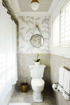 Neutral bathroom with Cole and Son Palm wallpaper in grey and white by The Zhush