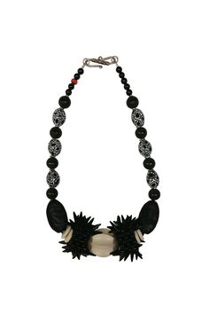 "An artisan necklace by Susan Vachon made with vintage African beads, onyx beads, black wire, and featuring a decorative silver tone clasp.    Dimensions: Approx. 18.25""L, Center Bead size: 1.25""L x 1""W   Black Bead Necklace by Susan Vachon. Accessories - Jewelry - Necklaces Massachusetts"
