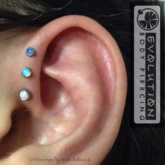 Fresh triple forward helix with opal in titanium jewelry by anatometal (at Evolution Piercing)