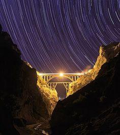 On instagram by mazandaran_iran #astrophotography #contratahotel (o) http://ift.tt/254j1W7. نمایی زیبا از ........ شما بگین کجاست  . کیا از روش رد شدن . Star trails above #bridge  Location:  #Iran  Photo by: Taha Ghouchkanlu Credit: #skypix.org Photo via @skypix.photo . #astronomy  #nightsky #photooftheday #photography #longexposure #nofilter #landscape #nature #nightphotography #astrophoto #starrynights #veresk #startrails #instadaily #longexposure_shots #نجوم #عکاسی #عکاسی_نجومی…