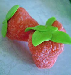 Simple No-Bake Strawberries: just jello, condensed milk & coconut. (use green taffy, fondant, mint leaves or a store bought tube of green icing for the leaves) These are not only delicious as a stand alone candy but also make lovely edible decorations on cupcakes, cakes & more.