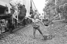 """Women of Las Patronas. For seventeen years, a group of women in La Patrona, Veracruz, has been handing out food and water to Central American migrants riding cargo trains north in search of work. Their story began in February, 1995 when two sisters, Bernarda Romero Vázquez and Rosa Romero Vázquez, were standing with their groceries at a train crossing in the village, waiting for the train to pass.  Migrants on the first train car began shouting, """"Madre, I'm hungry."""""""