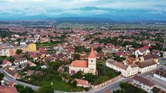 Aerial view of Avrig, with the Evangelical Church and the Carpathian Mountains in the background Lazy Summer Days, Medieval Fortress, Carpathian Mountains, Summer Palace, Months In A Year, World Heritage Sites, Aerial View, Nice View, Old Town