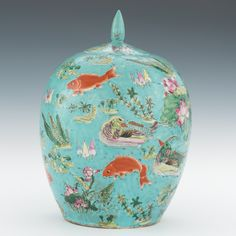 A Chinese Porcelain Melon Jar with Lid Hand decorated in enamels with fish, lotus, ducks and foliage in polychrome on a turquoise ground, six character marks in iron red underneath; bulbous shape porcelain container with lid.