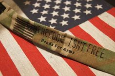 """To honor all American's serving within the United States Military, Nick created The Sacrifice Bracelet, inscribed with the words """"Freedom Isnt Free."""""""